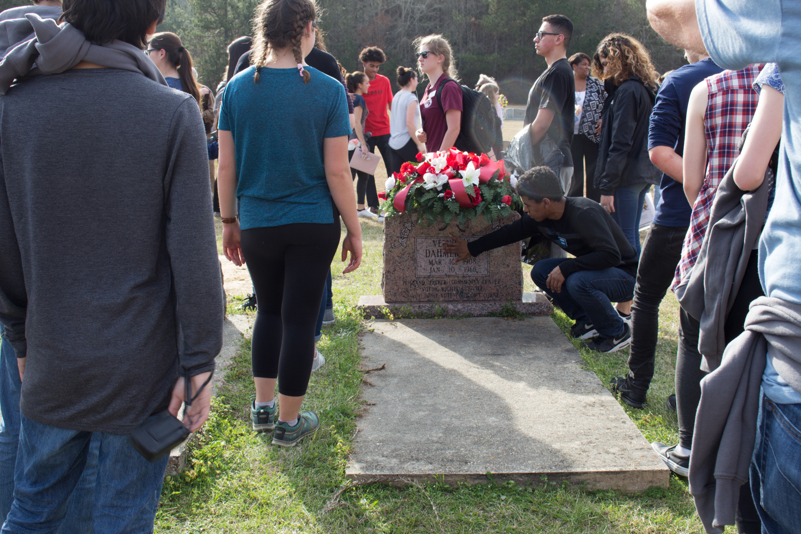 Students visit the grave of Vernon Dahmer, Sr.