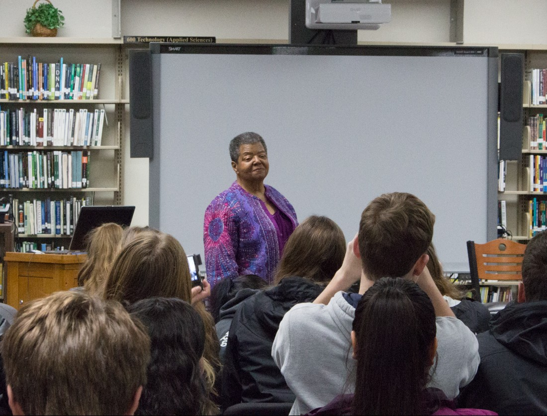 Elizabeth Eckford, posing for students at Little Rock Central High School