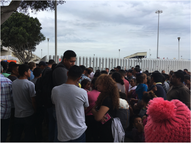 Hundreds gather each morning at El Chaparral port of entry in Tijuana