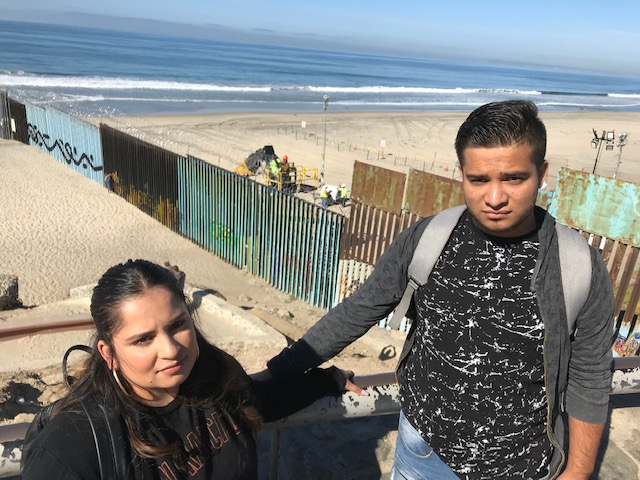 Soledad and Gabriel at the border fence in Playas Tijuana