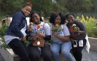 City Blossoms volunteers at urban garden